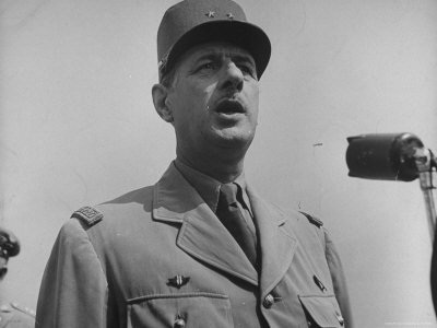 skadding-george-french-gen-charles-de-gaulle-speaking-into-mike-during-his-visit-with-us-officials.jpg